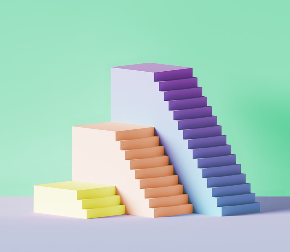 stair-shaped objects of different heights and colors in front of green background