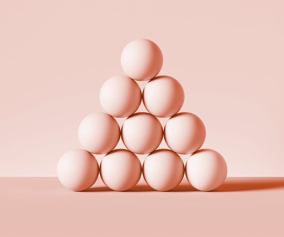 10 pink spheres stacked in pyramid on pink background