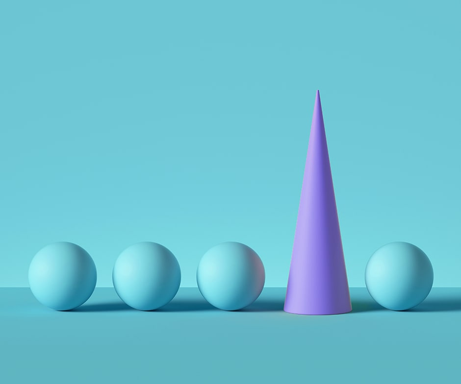 4 blue spheres with purple cone between 3rd and 4th sphere in front of blue background