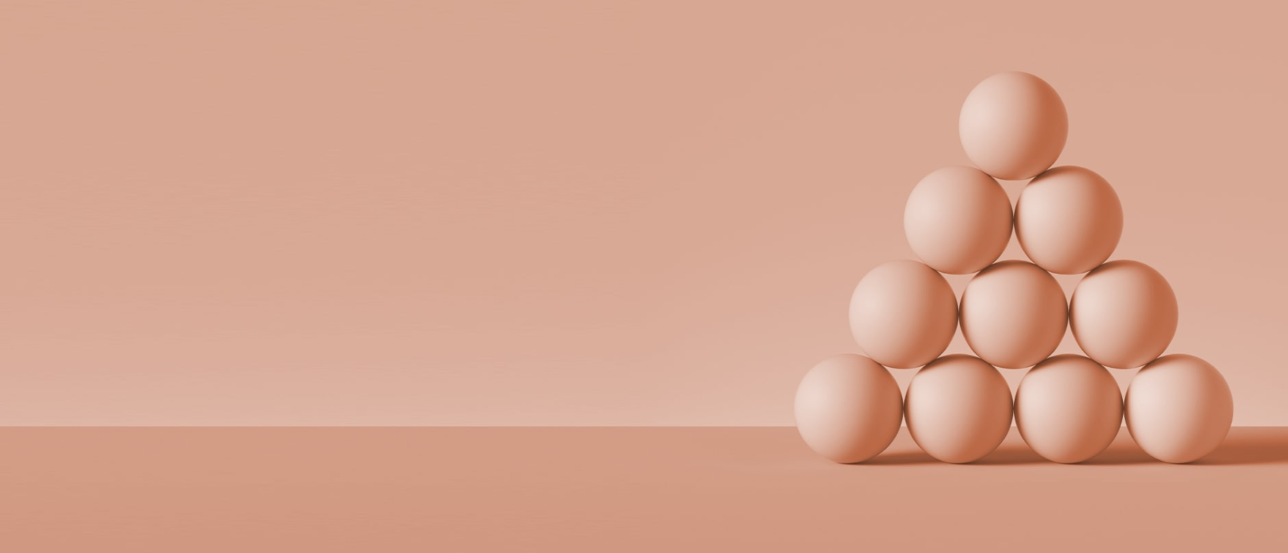 10 peach spheres arranged in a pyramid with peach background