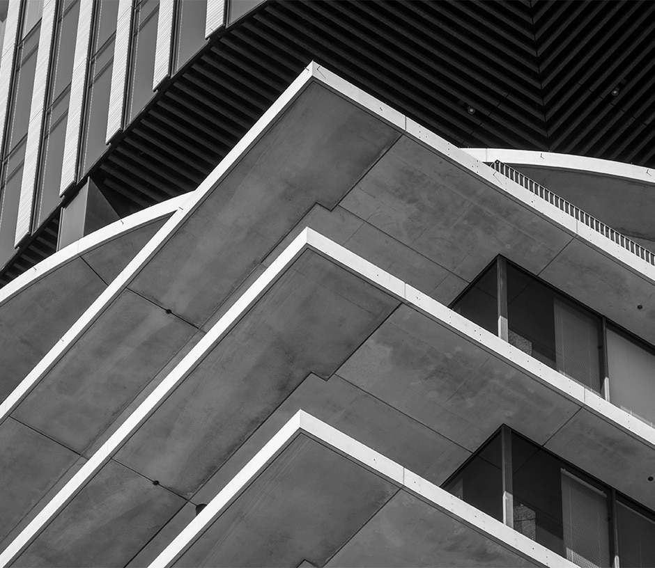 Edge of a square building in black and white