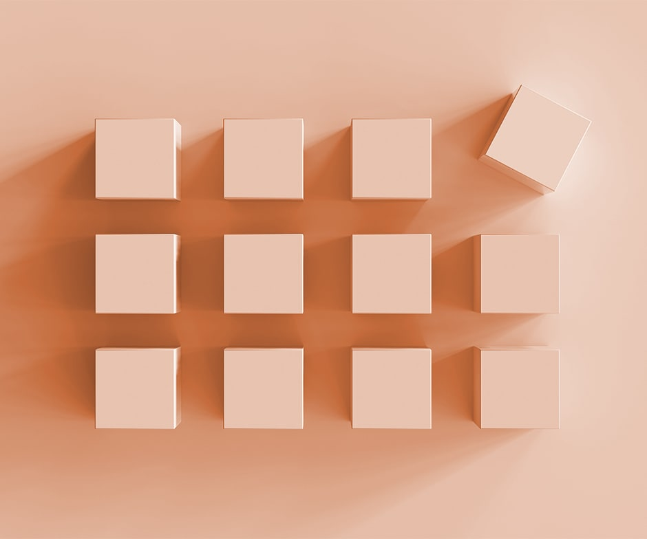 twelve pink cubes with one askew