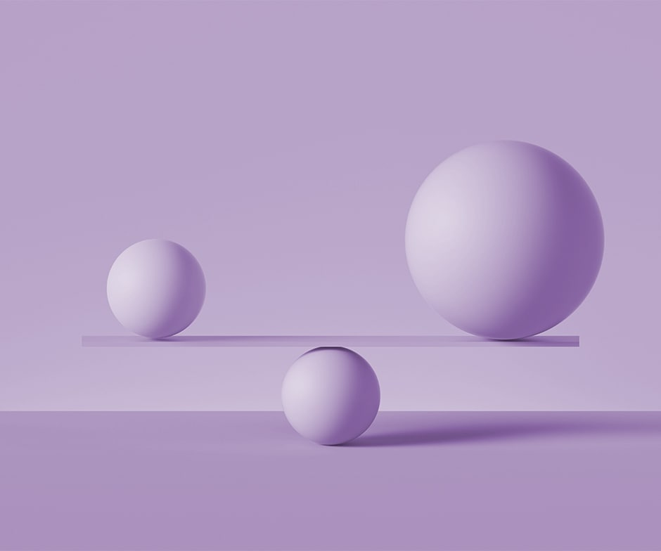 two purple spheres balancing on a purple board supported by a purple sphere