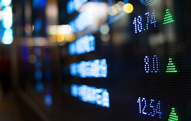 close up of electronic display of stock market activity