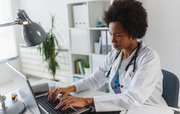 doctor working at desk in office