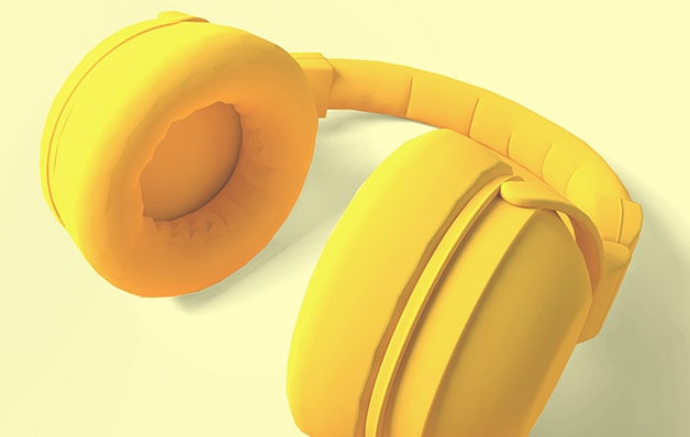 Yellow headphones on yellow background