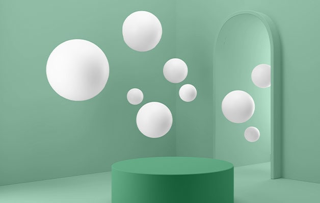 floating white spheres with a green cylinder on the ground in a green room