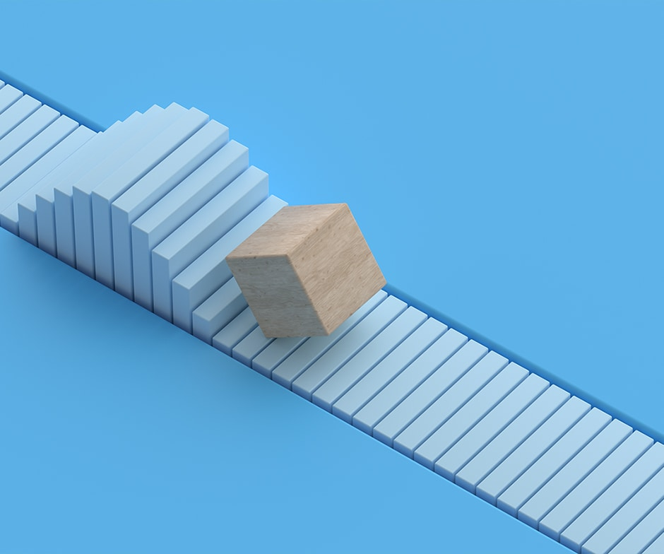 wooden block on a blue path with a bump in the path on a blue background