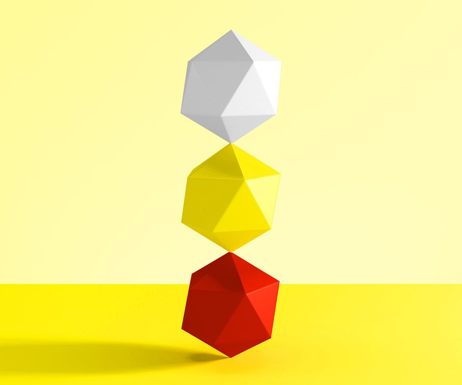 3 abstract shapes balancing on top of each other one red one yellow and one white. With a yellow background