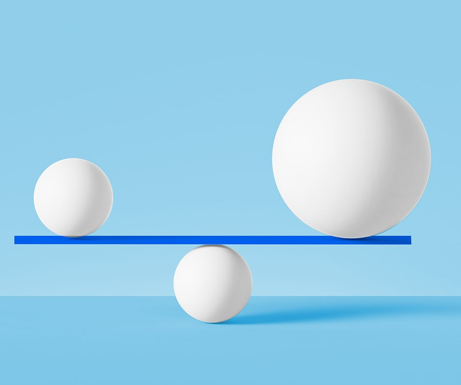 white balls balancing on blue background