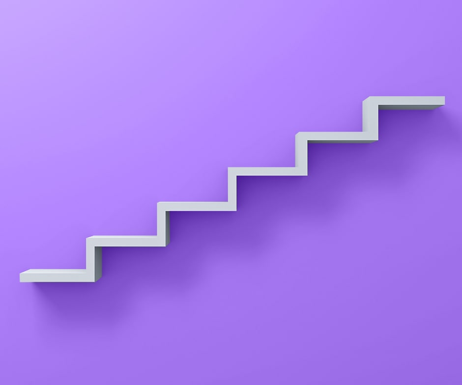 white stairs in front of purple background