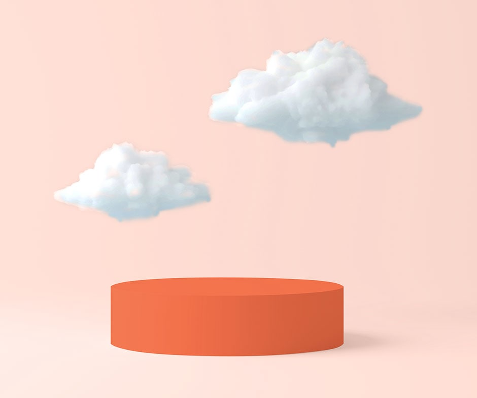 white clouds floating over orange circular platform in front of peach background