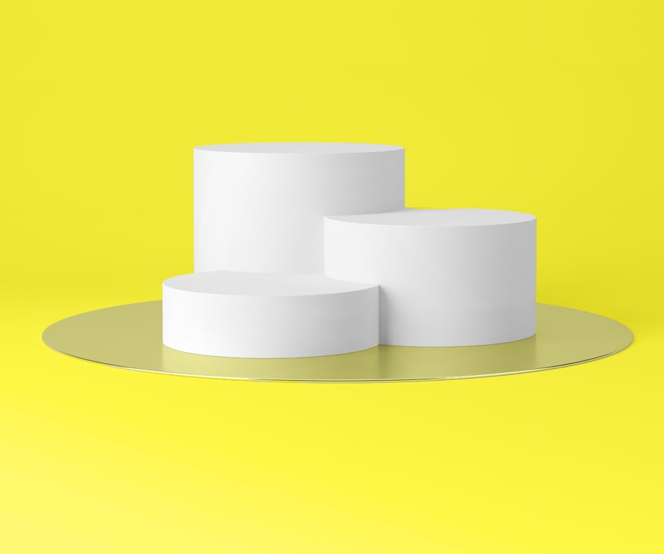white cylinders on yellow background