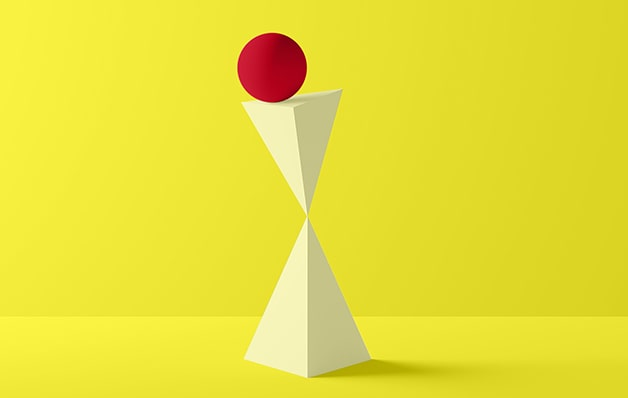 red ball balancing on mirrored triangular shapes