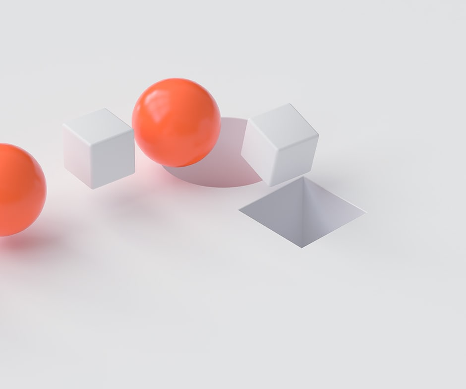 2 orange spheres and 2 white blocks with a cube shaped hole in the ground on a white background