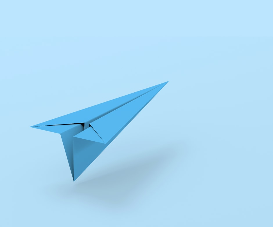 Blue paper airplane on a blue background