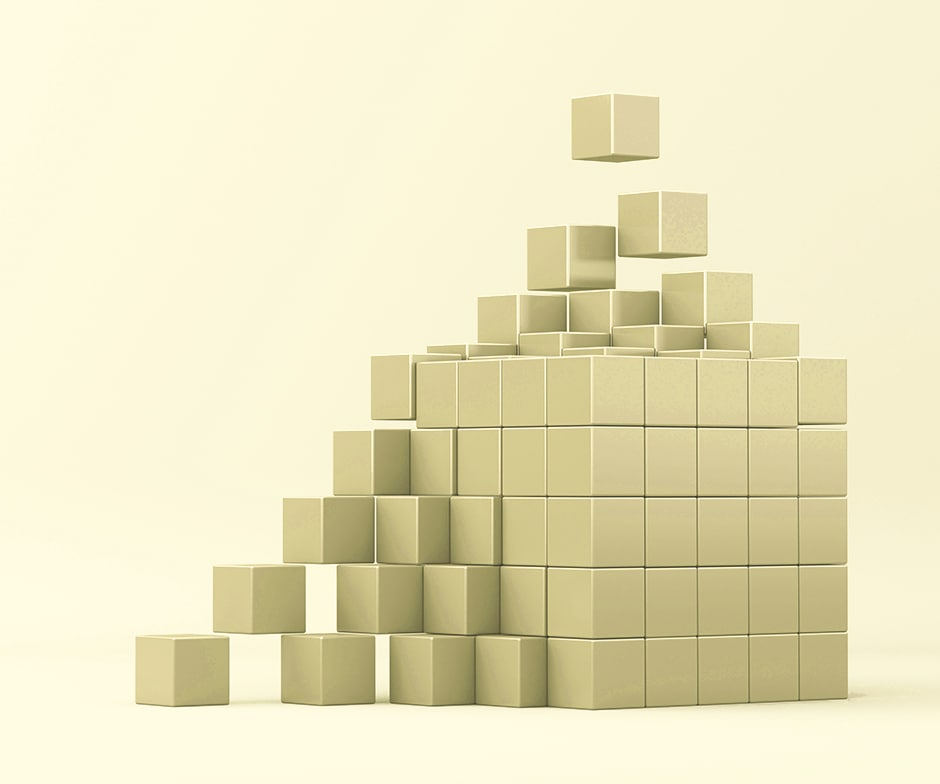 soft yellow background with small gold blocks coming together to form larger gold cube