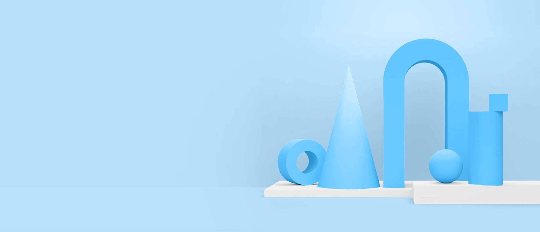 blue 3D shapes sitting on white platform with blue background