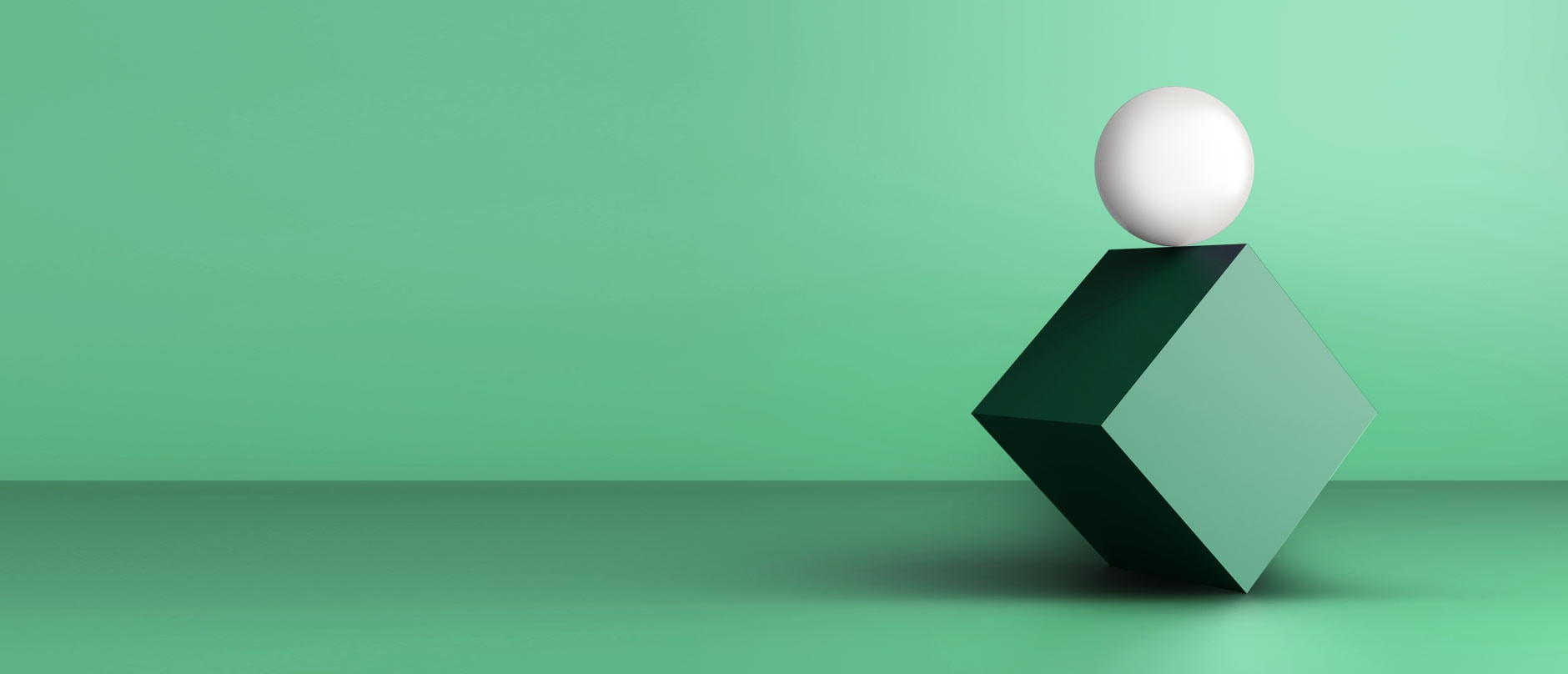 Green cube on its edge with a white sphere on top of it, with green background