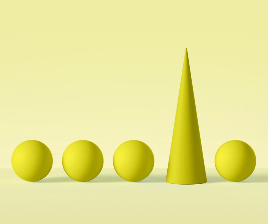 4 yellow spheres horizontally aligned with a yellow cone between the 3rd and 4th sphere all in front of yellow background