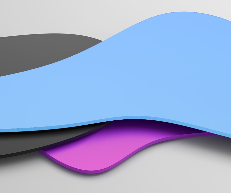gray background with 3 layered wave-shaped objects with fuschia on the bottom, dark gray and then blue on top