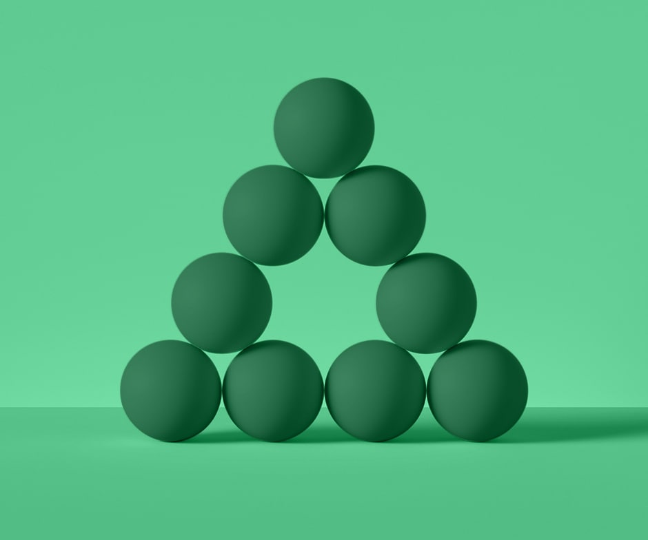 green background with 9 green spheres arranged in a pyramid, with the center piece missing